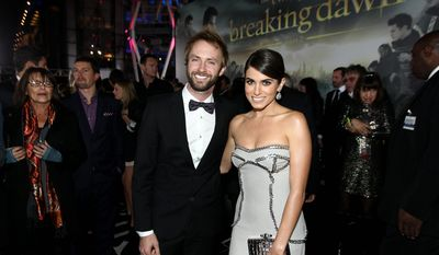 """Paul McDonald, left, and Nikki Reed attend the world premiere of """"The Twilight Saga: Breaking Dawn Part 2"""" at the Nokia Theatre on Monday, Nov. 12, 2012, in Los Angeles. (Photo by Matt Sayles/Invision/AP)"""