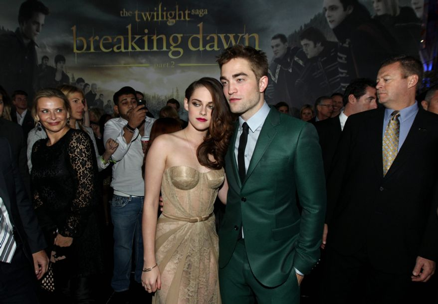 "Kristen Stewart, left, and Robert Pattinson attend the world premiere of ""The Twilight Saga: Breaking Dawn Part 2"" at the Nokia Theatre on Monday, Nov. 12, 2012, in Los Angeles. (Photo by Matt Sayles/Invision/AP)"