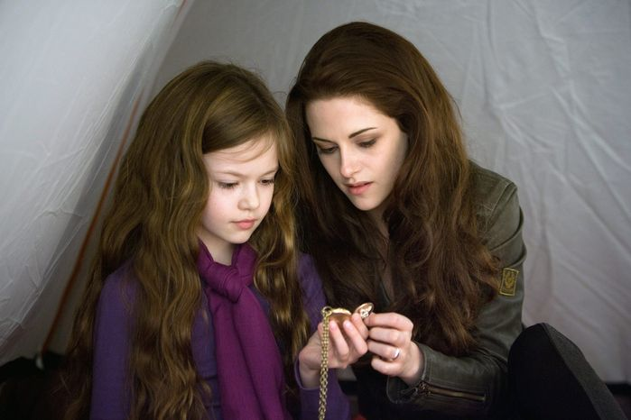 "This film image released by Summit Entertainment shows Mackenzie Foy, left, and Kristen Stewart in a scene from ""The Twilight Saga: Breaking Dawn Part 2."" (AP Photo/Summit Entertainment, Andrew Cooper)"