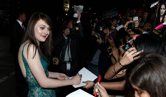 "Dakota Fanning attends the world premiere of ""The Twilight Saga: Breaking Dawn Part 2"" at the Nokia Theatre on Monday, Nov. 12, 2012, in Los Angeles. (Photo by Matt Sayles/Invision/AP)"