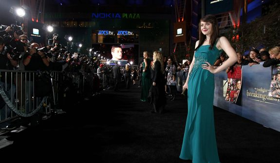 """Dakota Fanning attends the world premiere of """"The Twilight Saga: Breaking Dawn Part 2"""" at the Nokia Theatre on Monday, Nov. 12, 2012, in Los Angeles. (Photo by Matt Sayles/Invision/AP)"""
