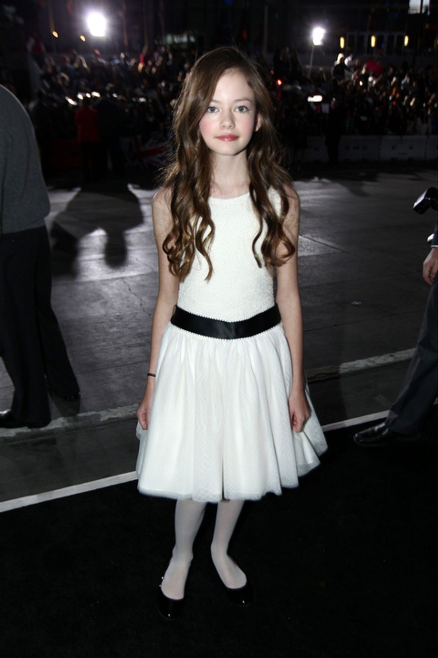 "Mackenzie Foy attends the world premiere of ""The Twilight Saga: Breaking Dawn Part 2"" at the Nokia Theatre on Monday, Nov. 12, 2012, in Los Angeles. (Photo by Matt Sayles/Invision/AP)"