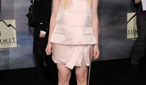 "Elle Fanning attends the world premiere of ""The Twilight Saga: Breaking Dawn Part 2"" at the Nokia Theatre on Monday, Nov. 12, 2012, in Los Angeles. (Photo by Jordan Strauss/Invision/AP)"
