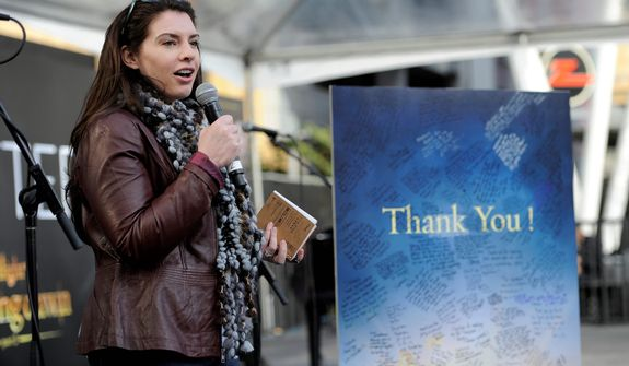 "Stephanie Meyer, author of the ""Twilight"" series of novels, speaks to fans alongside a ""Thank You"" message to her signed by crowd members during the Twilight Fan Camp Concert outside Nokia Theater L.A. Live, Saturday, Nov. 10. 2012, in Los Angeles. The world premiere of the film ""The Twilight Saga: Breaking Dawn Part 2"" will be held at Nokia Theater L.A. Live on Monday. (Photo by Chris Pizzello/Invision/AP)"