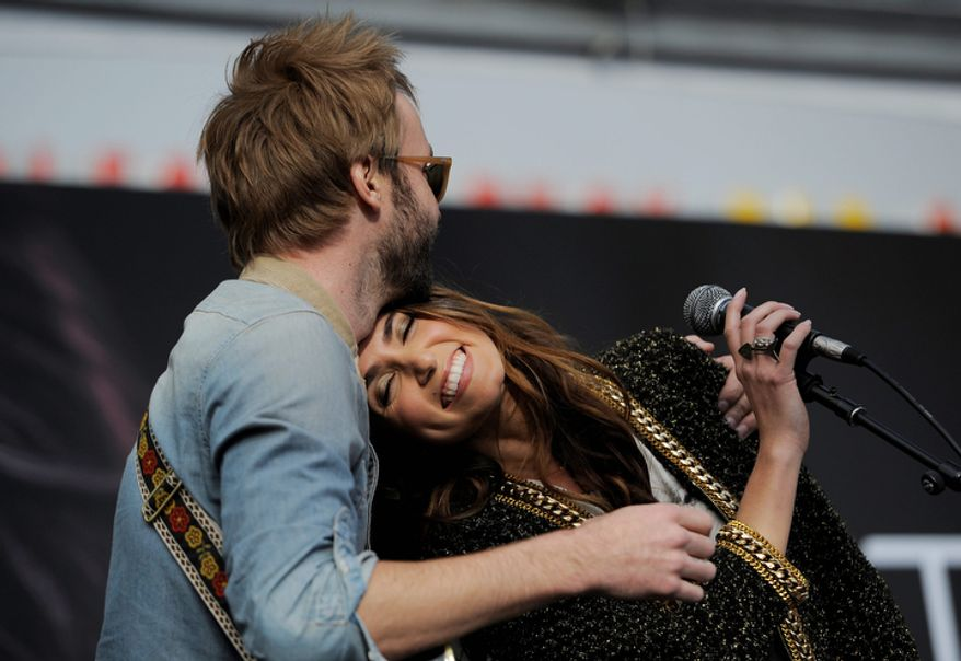 "Nikki Reed, a cast member in the film ""The Twilight Saga: Breaking Dawn Part 2,"" is embraced by her husband, singer Paul McDonald, as they perform together onstage during the Twilight Fan Camp Concert outside Nokia Theater L.A. Live, Saturday, Nov. 10. 2012, in Los Angeles. The world premiere of the film will be held at Nokia Theater L.A. Live on Monday. (Photo by Chris Pizzello/Invision/AP)"
