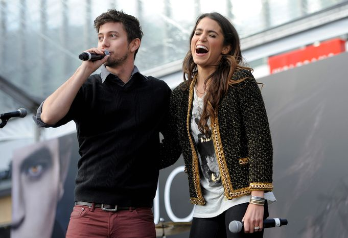 """Jackson Rathbone, left, and Nikki Reed, cast members in the film """"The Twilight Saga: Breaking Dawn Part 2,"""" appear onstage during the Twilight Fan Camp Concert outside Nokia Theater L.A. Live, Saturday, Nov. 10. 2012, in Los Angeles. The world premiere of the film will be held at Nokia Theater L.A. Live on Monday. (Photo by Chris Pizzello/Invision/AP)"""