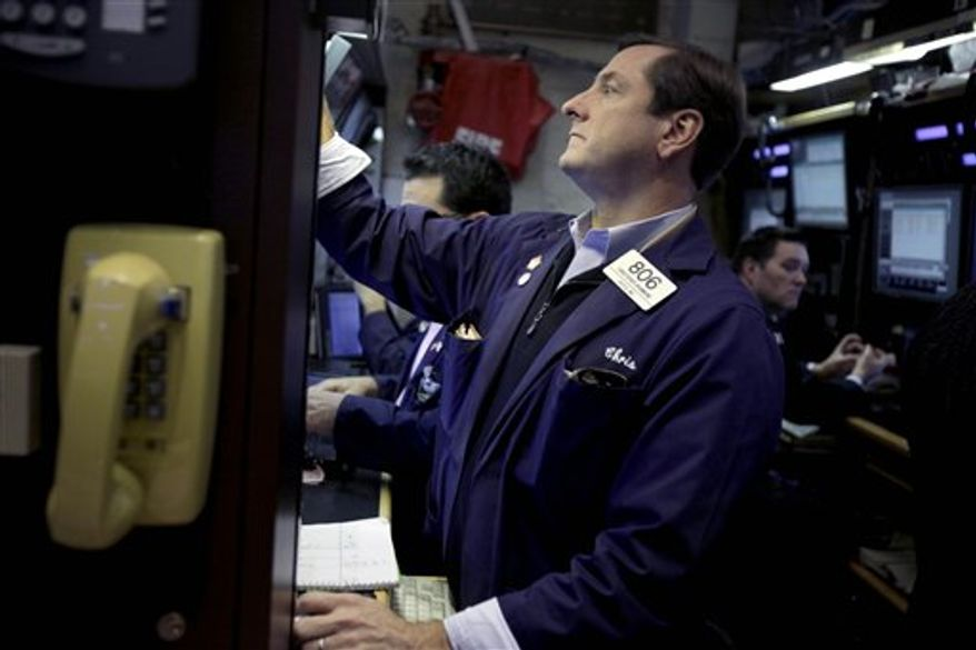 Traders work on the floor at the New York Stock Exchange, Thursday, Nov. 15, 2012. Stock indexes are inching higher in early trading Thursday after U.S. retail giants Wal-Mart and Target turned in mixed earnings reports. (AP Photo/Seth Wenig)