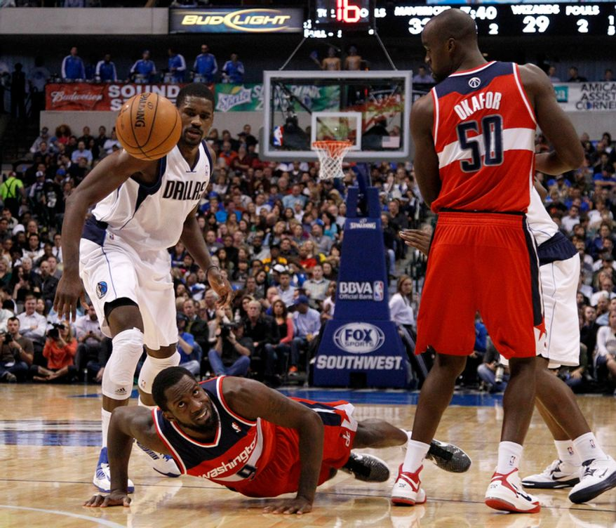 Washington Wizards' Martell Webster (9) loses control of the ball trying to get by Dallas Mavericks' Bernard James, left, as Emeka Okafor (50) watches in the first half of an NBA basketball game Wednesday, Nov. 14, 2012, in Dallas. (AP Photo/Tony Gutierrez)