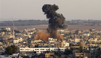 Smoke rises following an Israeli attack on Gaza City, Thursday, Nov. 15, 2012. (AP Photo/Hatem Moussa)