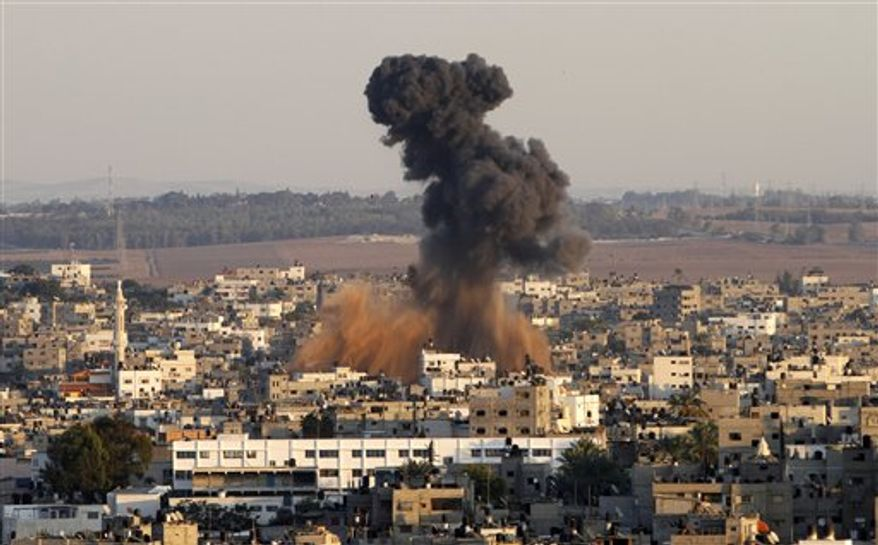 Smoke rises following an Israeli attack on Gaza City, Thursday, Nov. 15, 2012. (AP Photo/Hatem Moussa)