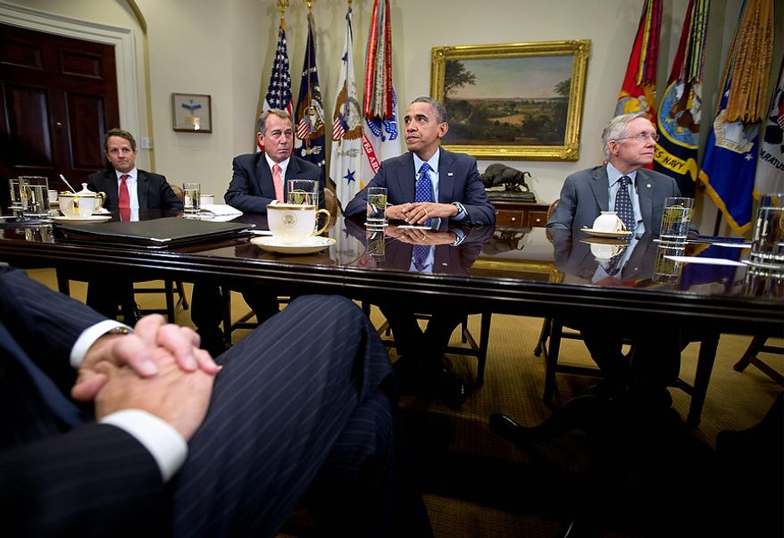 President Barack Obama pauses as he hosts a meeting of the bipartisan, bicameral leadership of Congress to discuss the deficit and economy, Friday, Nov. 16, 2012,  in the Roosevelt Room of the White House in Washington. From left are, Treasury Secretary Timothy Geithner, House Speaker John Boehner of Ohio, the president, and Senate Majority Leader Harry Reid of Nev. (AP Photo/Carolyn Kaster)