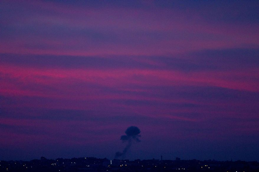 Smoke rises following an Israeli strike in the Gaza Strip, seen from the Israel Gaza Border, southern Israel, Friday, Nov. 16, 2012. (AP Photo/Ariel Schalit)