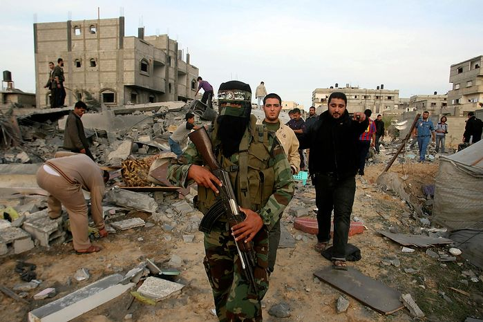 ** File ** A Palestinian Hamas militant walks in the rubble of the southern Gaza Strip, Nov. 16, 2012. (AP Photo/Eyad Baba)