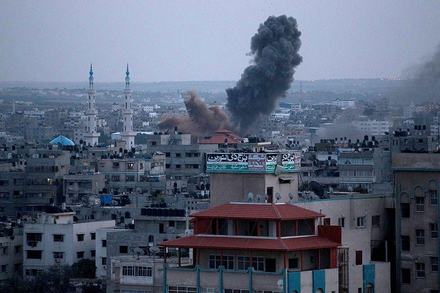 Smoke rises following an Israeli attack in Gaza City, Friday, Nov. 16, 2012. (AP Photo/Majed Hamdan)