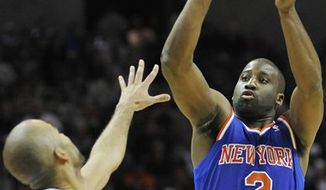New York Knicks' Raymond Felton, right, shoots over San Antonio Spurs' Tony Parker, of France, during the second half of an NBA basketball game on Thursday, Nov. 15, 2012, in San Antonio. New York won 104-100. (AP Photo/Darren Abate)