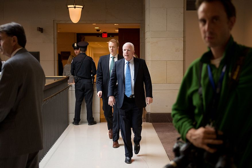 Sen. John McCain (R-Ariz.), center, heads to a closed door meeting with former CIA Director David Petraeus inside the Capitol Visitors Center on Capitol Hill, Washington, D.C., Friday, November 16, 2012. (Andrew Harnik/The Washington Times)