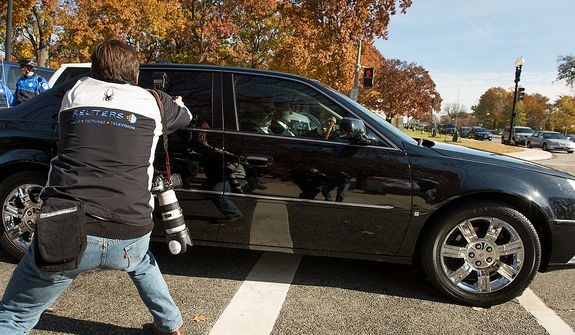 A member of the media photographs the car which it is believed to hold former CIA Director David Petraeus as he is driven away from the Capitol Building after meeting with lawmakers behind closed doors inside the Capitol Visitors Center, Washington, D.C., Friday, November 16, 2012. (Andrew Harnik/The Washington Times)