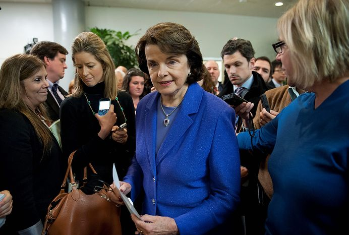 Senate Intelligence Committee Chair Sen. Dianne Feinstein, D-Calif.  is surrounded by reporters after speaking, on Capitol Hill in Washington, Friday, Nov. 16, 2012, following a committee's closed-door hearing where former CIA Director David Petraeus testified on the Sept. 11, 2012 attack in Libya. (AP Photo/Cliff Owen)
