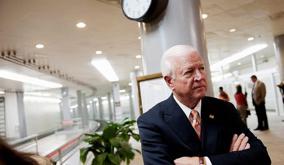 Senate Intelligence Committee Vice Chairman Sen. Saxby Chambliss, R-Ga. waits to speak with reporters on Capitol Hill in Washington, Friday, Nov. 16, 2012, following a closed-door hearing of the committee where former CIA Director David Petraeus testified. (AP Photo/Cliff Owen)