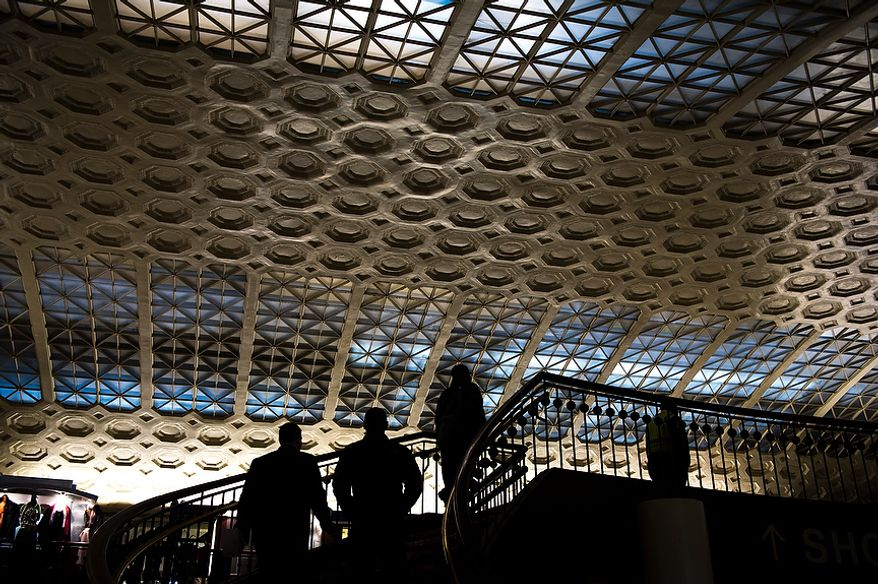 ** FILE ** People are silhouetted against the decorative ceiling and winding staircase in Union Station in Washington, D.C., Tuesday, Nov. 13, 2012. (Rod Lamkey Jr./The Washington Times) ** FILE **