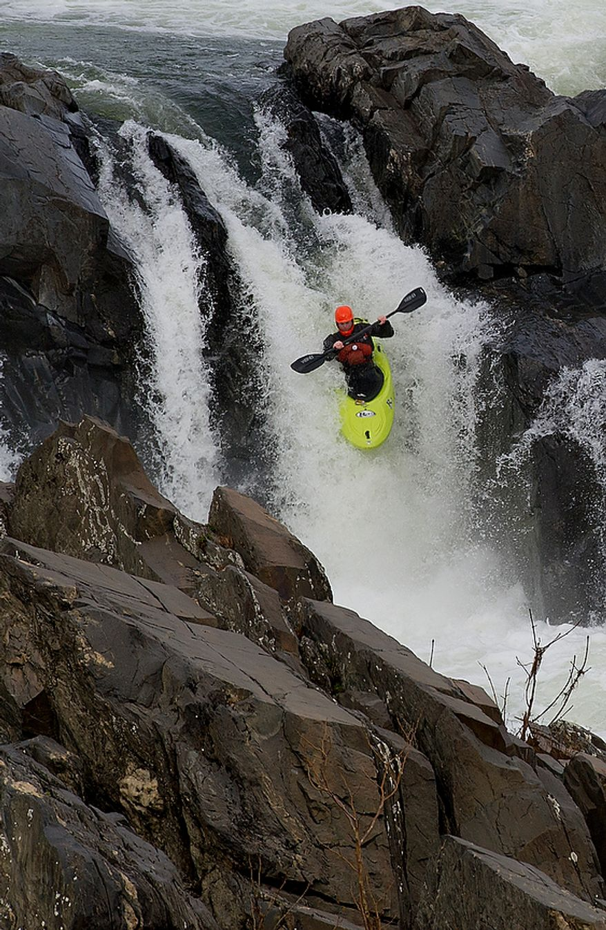 A kayaker makes his way down a waterfall at Great Falls Park in Virginia on Monday, Nov. 12, 2012. The park was free to the public in honor of Veteran's Day weekend, and with the mild weather and a day off of work, lots of people came out to enjoy some fresh air. (Barbara L. Salisbury/The Washington Times)