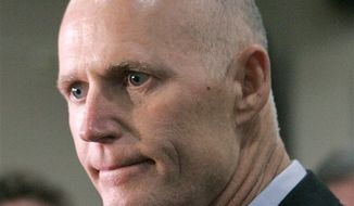 """** FILE ** This June 28, 2012, file photo shows Florida Gov. Rick Scott in Tallahassee, Fla. From the South to the heartland, cracks are appearing in the once-solid wall of Republican resistance to President Barack Obama's health care law. One of the most visible opponents of Obama's overhaul, Florida Republican Gov. Rick Scott, now says: """"if I can get to yes, I want to get to yes."""" (AP Photo/Steve Cannon, File)"""