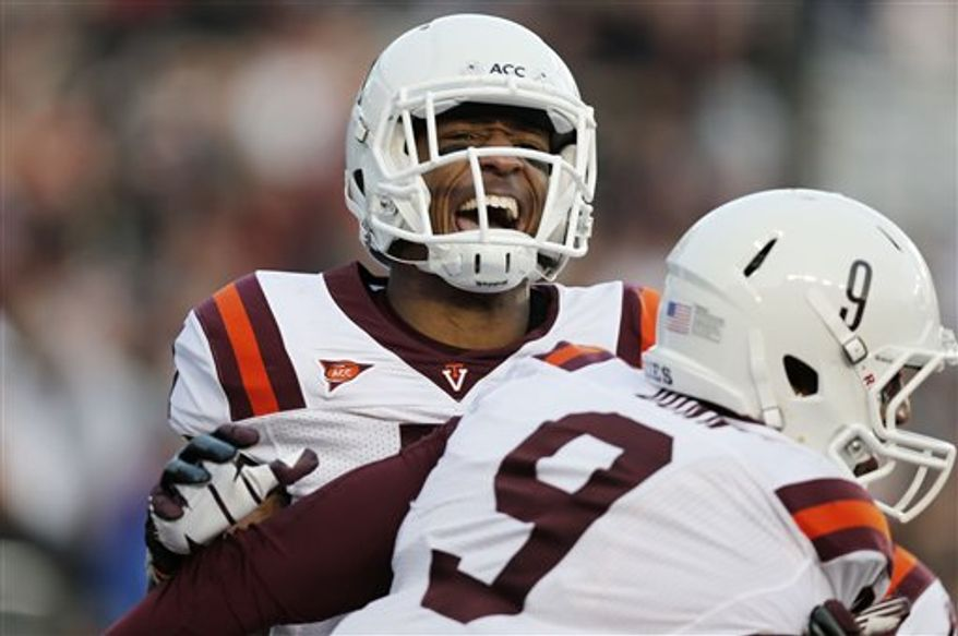 Virginia Tech's Marcus Davis congratulkates teammate Randall Dunn (9) after Dunn caught the game-winning touchdown pass in their 30-23 win in overtime against Boston College in a NCAA football game at Alumni Stadium in Boston Saturday, Nov. 17, 2012. (AP Photo/Winslow Townson)