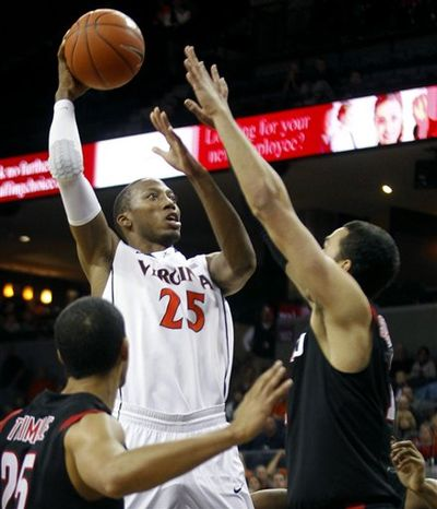 Virginia's Akil Mitchell (25) shoots over Seattle's David Trimble(25) and Clarence Trent (12) during an NCCA college basketball game on Saturday, Nov. 17, 2012, in Charlottesville, Va. (AP Photo/The Daily Progress, Andrew Shurtleff)