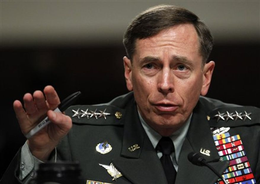 In this June 29, 2010 file photo, Gen. David Petraeus testifies before the Senate Armed Services Committee on Capitol Hill in Washington. Petraeus, the retired four-star general who led the U.S. military campaigns in Iraq and Afghanistan, resigned Friday, Nov. 9, 2012 as director of the CIA after admitting he had an extramarital affair. (AP Photo/Pablo Martinez Monsivais, File)