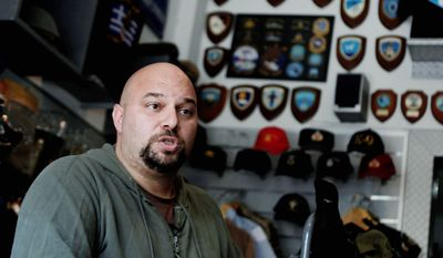 Golden Dawn party lawmaker Ilias Panagiotaros rejects accusations by human rights and immigrant groups that his party has been involved in racist attacks in Greece. (Associated Press)