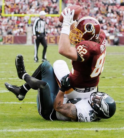 Preston keres/special to the Washington Times Tight end Logan Paulsen scored on this 17-yard catch, and Aldrick Robinson had a 49-yarder in the second quarter.