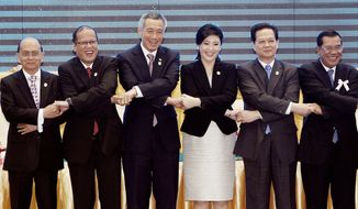 From left, Thein Sein, president of Myanmar; Benigno Aquino III, president of the Philippines; Lee Hsien Loong, prime minister of Singapore; Yingluck Shinawatra, prime minister of Thailand; Nguyen Tan Dung, prime minister of Vietnam; and Hun Sen, prime minister of Cambodia, join hands after a signing ceremony of adoption of the ASEAN Human Rights Declaration during a summit for the association in Phnom Penh, Cambodia, on Sunday. (Associated Press)