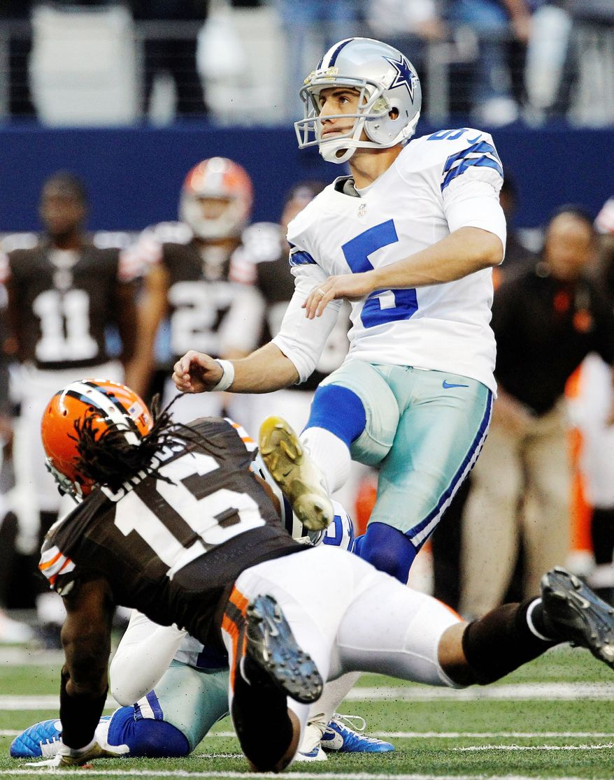 Dallas kicker Dan Bailey follows through on a 32-yard field goal with 2 seconds left in regulation. Bailey hit from 38 yards in overtime to seal a 23-20 comeback victory over Cleveland. (Associated Press)