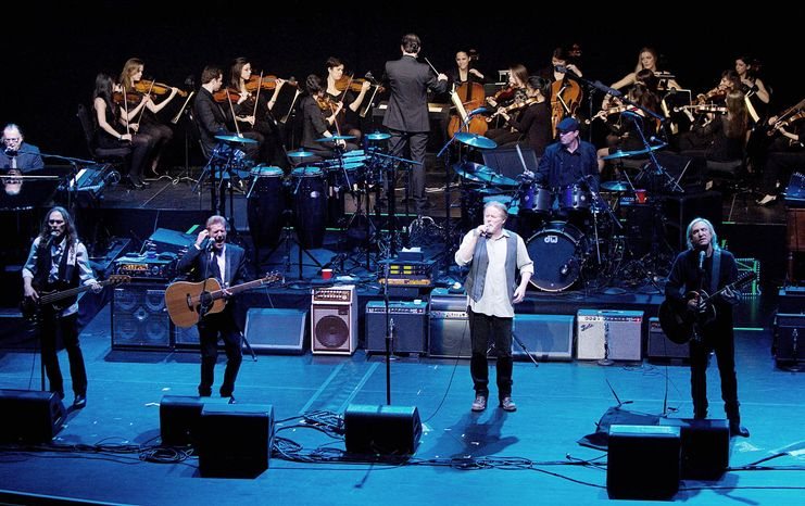 The New York University Steinhardt orchestral string ensemble performed Thursday with members of the Eagles (from left) Timothy B. Schmit, Glenn Frey, Don Henley and Joe Walsh. Mr. Frey has been teaching a songwriting class at NYU. (New York University via Associated Press)