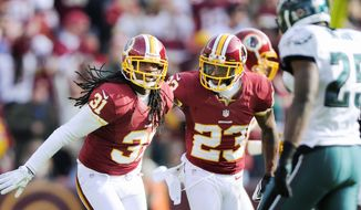 Playing in his first game this year, Redskins free safety Brandon Meriweather (left) celebrates his second-quarter interception with cornerback DeAngelo Hall. Meriweather suffered a torn ACL in the win against the Eagles, ending his season. (Preston Keres/Special to The Washington Times)