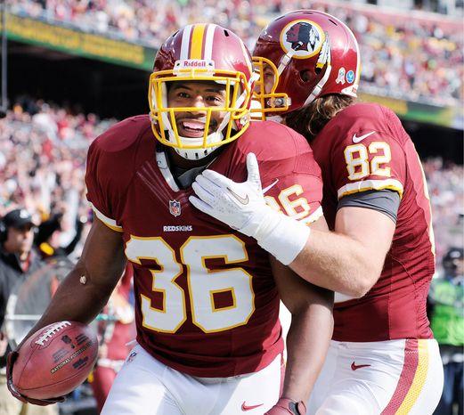 Washington Redskins fullback Darrel Young (36) celebrates his first-quarter touchdown with tight end Logan Paulsen (82) at FedEx Field, Landover, Md., Nov. 18, 2012. (Preston Keres/Special to The Washington Times)