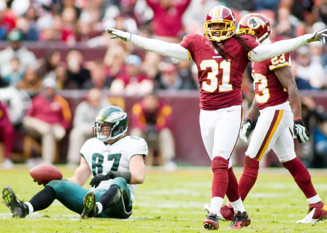 Redskins free safety Brandon Meriweather (31) celebrates after forcing an incomplete pass intended for Eagles tight end Brent Celek during in the second half. The Eagles' offense sputtered throughout the Redskins' 31-6 win at FedExField. (Criag Bisacre/The Washington Times)