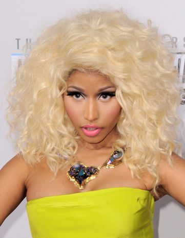 Nicki Minaj arrives at the 40th Anniversary American Music Awards on Sunday, Nov. 18, 2012, in Los Angeles. (Photo by Jordan Strauss/Invision/AP)