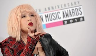 Cyndi Lauper arrives at the 40th Anniversary American Music Awards on Sunday, Nov. 18, 2012, in Los Angeles. (Photo by John Shearer/Invision/AP)