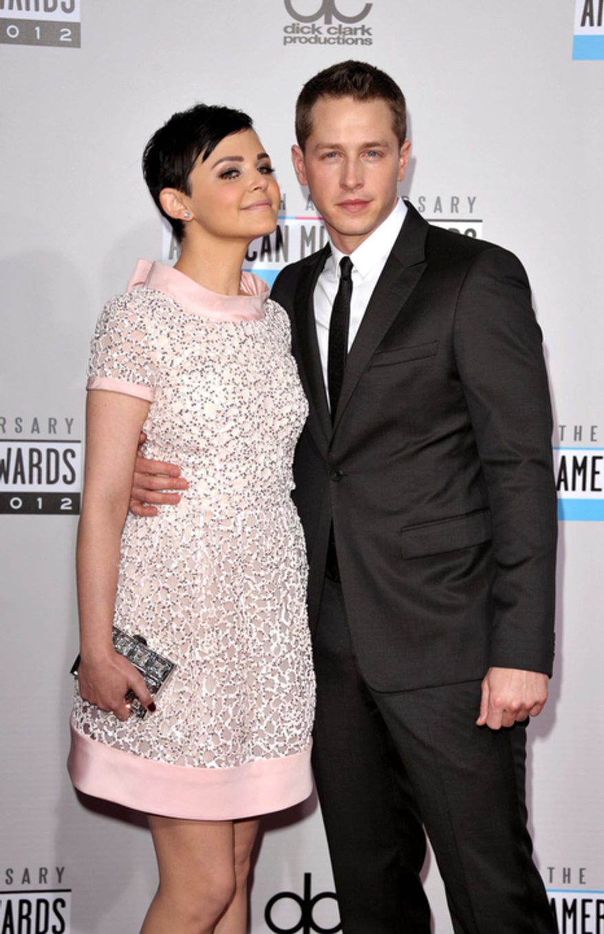 Ginnifer Goodwin, left, and Josh Dallas arrive at the 40th Anniversary American Music Awards on Sunday, Nov. 18, 2012, in Los Angeles. (Photo by John Shearer/Invision/AP)