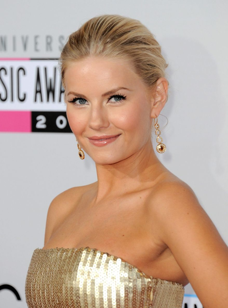 Elisha Cuthbert arrives at the 40th Anniversary American Music Awards on Sunday, Nov. 18, 2012, in Los Angeles. (Photo by Jordan Strauss/Invision/AP)