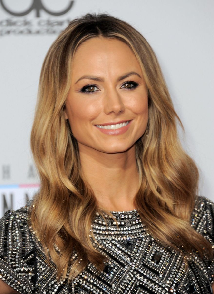 Stacy Keibler arrives at the 40th Anniversary American Music Awards on Sunday, Nov. 18, 2012, in Los Angeles. (Photo by Jordan Strauss/Invision/AP)