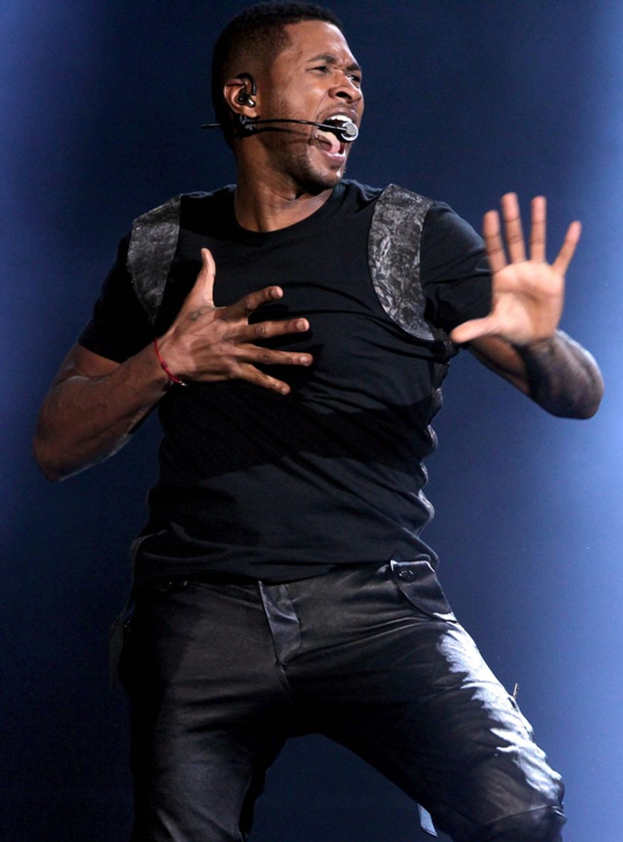 Usher performs at the 40th Annual American Music Awards on Sunday, Nov. 18, 2012, in Los Angeles.(Photo by Matt Sayles/Invision/AP)