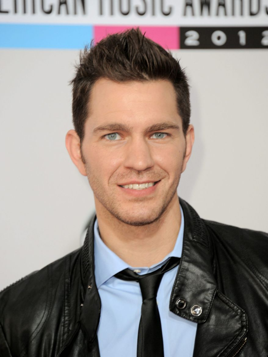 Andy Grammer arrives at the 40th Anniversary American Music Awards on Sunday Nov. 18, 2012, in Los Angeles. (Photo by Jordan Strauss/Invision/AP)