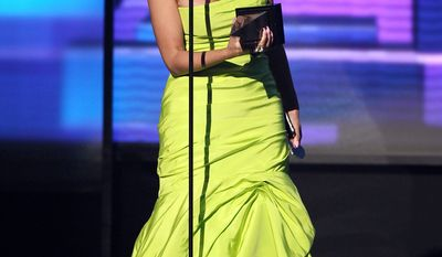 Nicki Minaj accepts the award for favorite album - rap/hip-hop ìPink Friday: Roman Reloadedî at the 40th Annual American Music Awards on Sunday, Nov. 18, 2012, in Los Angeles. (Photo by Matt Sayles/Invision/AP)