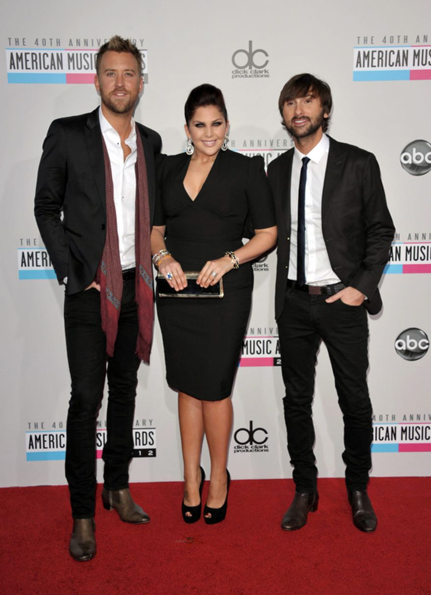 Charles Kelley, left, Hillary Scott, center, and Dave Haywood from the band Lady Antebellum arrive at the 40th Anniversary American Music Awards on Sunday, Nov. 18, 2012, in Los Angeles. (Photo by John Shearer/Invision/AP)