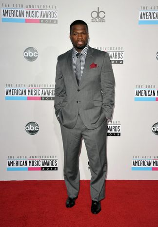 50 Cent arrives at the 40th Anniversary American Music Awards on Sunday, Nov. 18, 2012, in Los Angeles. (Photo by John Shearer/Invision/AP)