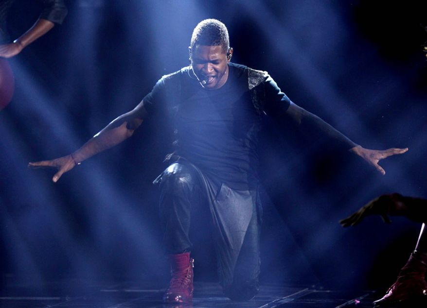 ** FILE ** Usher performs at the 40th Annual American Music Awards on Sunday, Nov. 18, 2012, in Los Angeles. (Photo by Matt Sayles/Invision/AP)