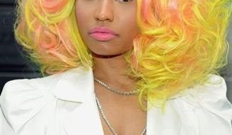"""** FILE ** In this Sept. 16, 2012, file photo, """"American Idol"""" Season 12 judge Nicki Minaj arrives for day one auditions at Jazz at Lincoln Center, in New York. (Photo by Evan Agostini/Invision/AP, File)"""