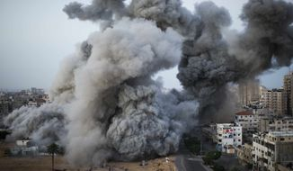 Smoke rises after an Israeli forces strike in Gaza City, Sunday, Nov. 18, 2012. (AP Photo/Bernat Armangue)